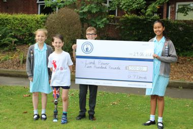 School Donates Money to Young Amputee